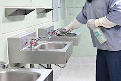 An incarcerated individual cleans a sink. (Courtesy of Maryland Department of Public Safety and Correction Services)