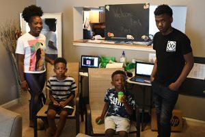 Angel Johnson (left) with her three school-age children Asahai, Khalil and James (Roy Lewis/The Washington Informer)