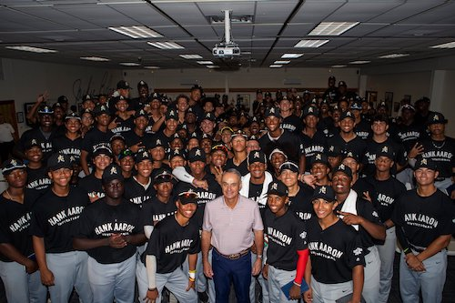 Major League Baseball Commissioner Rob Manfred and a group of youth participating in league-backed activities (Courtesy of MLB)