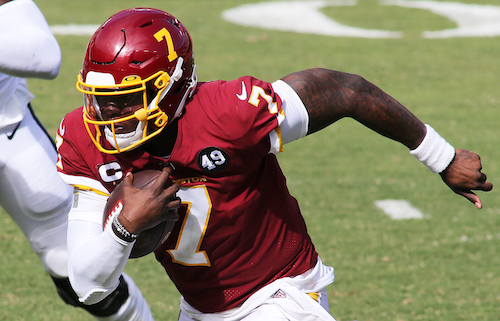Washington Football Team quarterback Dwayne Haskins breaks free for a big gain. (Daniel Kucin Jr./The Washington Informer)