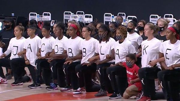 The WNBA Mystics shirts spelled out the name of Jacob Blake in the front and seven fake bullet holes in the back to protest the shooting of Blake who was shot seven times in the back by police in Kenosha, Wisconsin. (Courtesy photo)