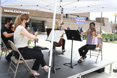 A select tandem of musicians from the National Symphony Orchestra performs at Howard University Hospital in D.C. during an outdoor concert for the staff, doctors and patients on Sept. 11. (Roy Lewis/The Washington Informer)