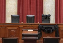 The courtroom of the Supreme Court showing Associate Justice Ruth Bader Ginsburg's Bench Chair and the Bench in front of her seat draped in black following her death on Sept. 18, 2020. (Fred Schilling/Collection of the Supreme Court of the United States)