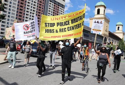 **FILE** Demonstrators participate in the National Day of Protests Against Racism & Political Repression in Baltimore on May 30, 2020. (Elvert Barnes Photography via Wikimedia Commons)