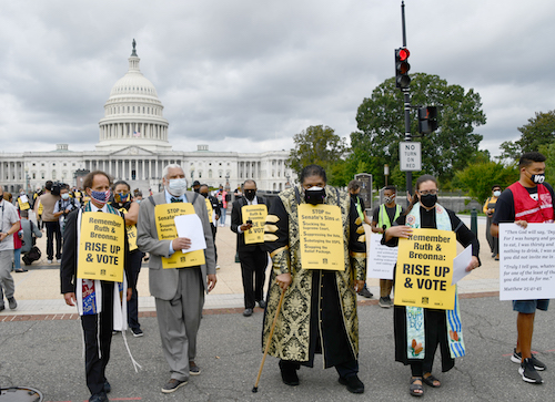 Faith leaders gather at the Supreme Court building in D.C. for a silent walk led by the Rev. Dr. William Barber, co-chair of the Poor People's Campaign towards the Senate office buildings on Sept. 29. (Anthony Tilghman/The Washington Informer)
