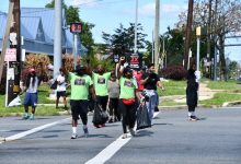 Photo of Local Graduates Work to Clean a Disadvantaged Community in Need