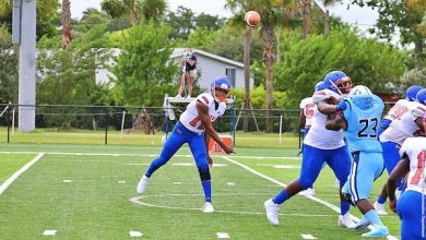 Florida Memorial quarterback Antoine Williams attempts a pass in the university's first game since 1958. (Florida Memorial Athletic Department via Howard University News Service)
