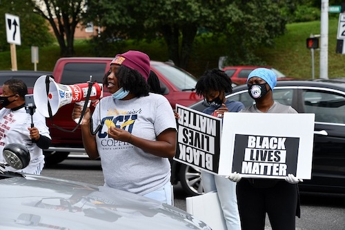 Janna Parker (center) speaks during a rally against police brutality in Fort Washington, Maryland, on Sept. 12. (Anthony Tilghman/The Washington Informer)