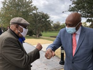Carroll Braxton (left) speaks with singer Joe Coleman during an Oct. 24 event at Jennie Dean Elementary School in Manassas, Virginia, to unveil a statue dedicated to the school's namesake. (Courtesy of Nkoyo Iyamba)