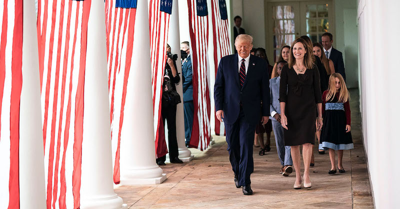 **FILE** President Donald J. Trump walks with Judge Amy Coney Barrett, his nominee for Associate Justice of the Supreme Court of the United States, along the West Wing Colonnade on Saturday, September 26, 2020, following announcement ceremonies in the Rose Garden. (Shealah Craighead/The White House)