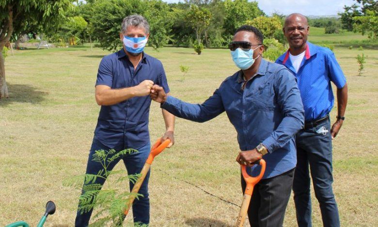 **FILE** Gustave Pandiani, Argentina's outgoing Ambassador to Barbados, and Adrian Forde, Minister of the Environment and National Beautification, fist-bump following the planting of a jacaranda tree at the National Botanical Gardens. (A. Reid/BGIS)