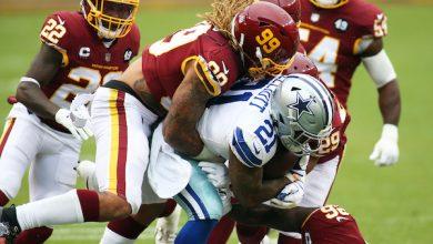 The Washington Football Team defense takes down Dallas Cowboys running back Ezekiel Elliott on Oct. 25. (Daniel Kucin Jr./The Washington Informer)