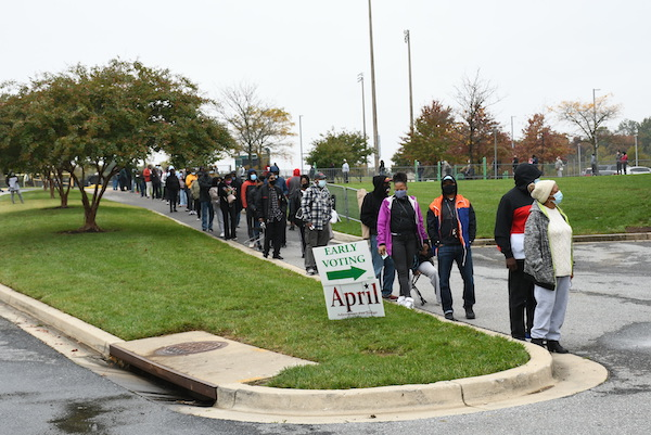 Prince George's County voters stood in long lines to cast early ballots on the first day of early voting in the county. (Roy Lewis/The Washington Informer)