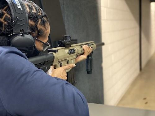 An African American woman shoots a firearm at a gun range. (Courtesy photo)