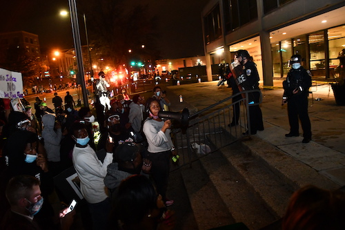 Maureen Brown (with bullhorn) participates in an Oct. 28 protest outside the Metropolitan Police Department's Fourth District Station with friends and family of Karon Hylton, a 20-year-old man who died from injuries suffered in a vehicle collision during a police pursuit five days earlier. (Anthony Tilghman/The Washington Informer)