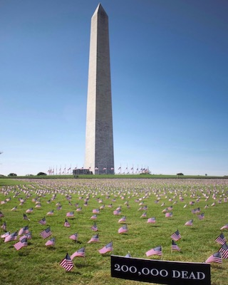 The grounds of the Washington Monument were covered with 200,000 flags symbolizing the number of people who have died from COVID-19. (Anthony Tilghman/ The Washington Informer)