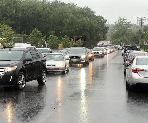 **FILE** Motorists line up for free coronavirus testing at the Hyattsville vehicle emission station. (Anthony Tilghman/The Washington Informer)