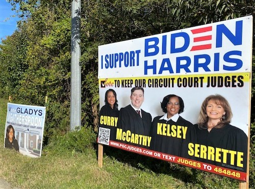 A campaign sign for the four incumbent Prince George's County Circuit Court judges is posted along Route 202 in Upper Marlboro on Oct. 9. Another campaign sign for a fifth judicial candidate, Gladys Weatherspoon, sits to the left. (William J. Ford/The Washington Informer)