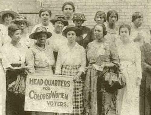 "Black women suffragists holding sign reading ""Head-Quarters for Colored Women Voters,"" in Georgia, 1910-1920 (Courtesy of NYPL)"