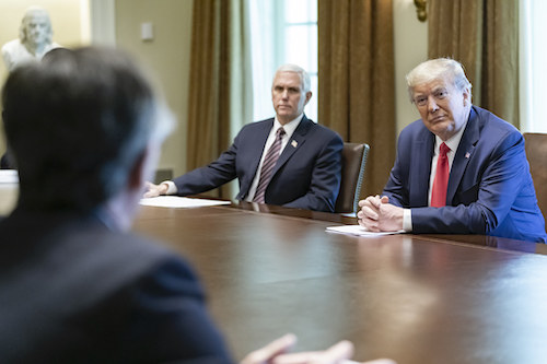 In a photo dated April 2020, President Donald J. Trump and Vice President Mike Pence meet with patients who recovered from COVID-19 in the Cabinet Room of the White House. (Courtesy of whitehouse.gov)