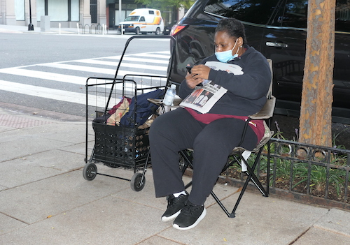 Latishia Wynn 49, sits at the corner of 11th and F in Northwest selling Street Sense says she is homeless due to domestic violence but expects to have housing soon. (Shevry Lassiter/The Washington Informer)