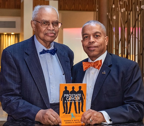 Thomas A. Butts and Derrick A. Butts hold the book they co-authored on prostate cancer. (Courtesy photo)