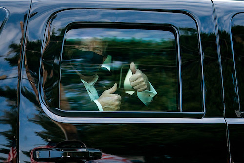 **FILE** President Donald J. Trump greets supporters during a drive by outside of Walter Reed National Military Medical Center Sunday, Oct. 4, 2020, in Bethesda, Md. (Official White House Photo by Tia Dufour)
