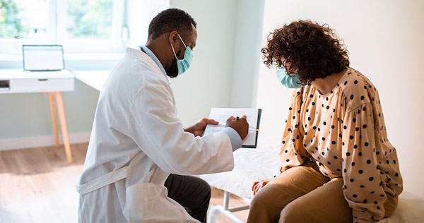 A patient is examined by a doctor. (Courtesy of harvardpilgrim.org)