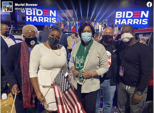 D.C. Mayor Muriel Bowser joined Biden campaign adviser Symone Sanders in Delaware for the victory speeches of President-elect Joe Biden and Vice President-elect Kamala Harris. (Courtesy photo/Facebook grab)