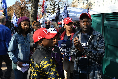 A Black family from North Carolina joins white nationalist groups and other Trump supporters to protest the election of President-elect Joe Biden and Vice President-elect Kamala Harris at Freedom Plaza in northwest D.C. on Nov. 14. (Roy Lewis/The Washington Informer)