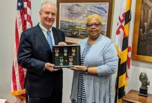 On July 24, 2019, at the Philip A. Hart Senate Office Building in Washing- ton, D.C., Sen. Chris Van Hollen (D-Md.) presented Brenda Siler with duplicate medals earned by her father Floyd H. Siler, Sr. Medals included those earned for service in Normandy on D-Day. (Photo courtesy of Brenda C. Siler)