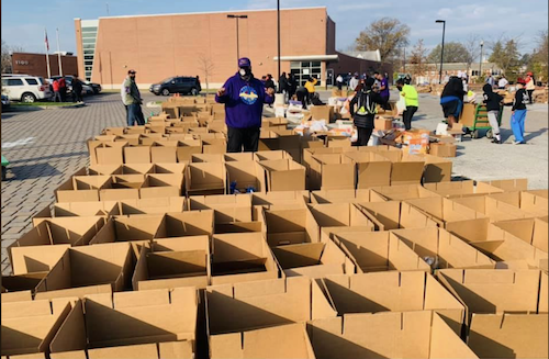 Volunteers at Turkey Thicket Recreation Center in Northeast prepare food baskets for the 26th annual Project GiveBack founded by Ransom Miller III. The goal is to feed 2,700 families in the District, Southern Maryland and Northern Virginia. (Courtesy photo)