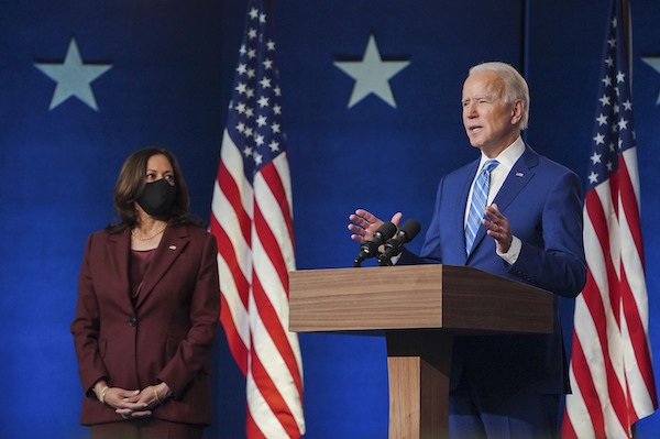 **FILE** 2020 Democratic presidential nominee Joe Biden speaks in Wilmington, Del., on Nov. 4 while running mate Kamala Harris listens. (Courtesy of the Biden campaign via Twitter)