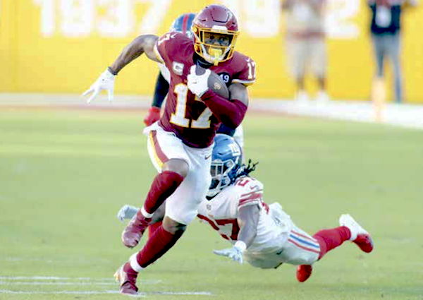 Washington Football Team wide receiver Terry McLaurin evades a tackle attempt by New York Giants defensive back Isaac Yiadom en route to a 68-yard touchdown reception in the fourth quarter of the Giants' 23-20 win at FedEx Field in Landover, Md., on Nov. 8. (Daniel Kucin Jr./The Washington Informer)