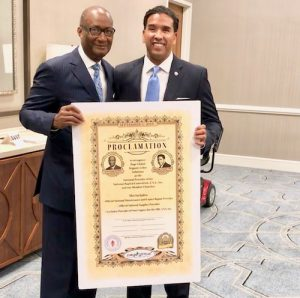 Jerry Young, president of the National Baptist Convention, USA, Inc., and Jimi Page, president and CEO of Page Global, display the proclamation recognizing Page Global as an official provider for National Baptist Convention, USA, Inc. (Courtesy photo)
