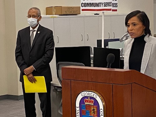 Prince George's County Executive Angela Alsobrooks speaks during a Nov. 12 press conference at the county's emergency operations center to give an update on Prince George's response to the ongoing coronavirus pandemic as Ernest Carter, left, the county's chief health officer, listens. (William J. Ford/The Washington Informer)