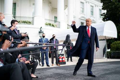 **FILE** President Donald J. Trump gives a fist bump to the press Friday, Oct. 30, 2020, prior to boarding Marine One en route to Joint Base Andrews, Md. to begin his trip to Michigan, Wisconsin and Minnesota. (Official White House Photo by Tia Dufour)