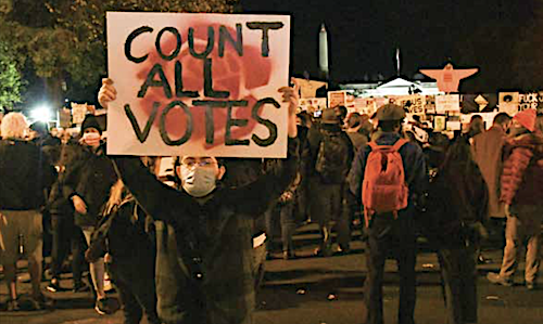 Black Lives Matter Plaza was the rallying point for the public and the press to watch and wait for election results on Nov. 3. (Roy Lewis/The Washington Informer)