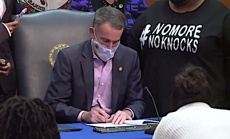 """Virginia Gov. Ralph Northam signs on Dec. 7 a measure known as """"Breonna's Law"""" that bans police from using no-knock search warrants."""