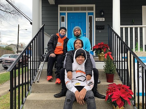 Spring Cambric (left) and her children (from top) Brandon, Kaila and Quentin enjoy the porch of their new home through Habitat for Humanity in the Chestnut Hills neighborhood of Richmond's North Side. (Courtesy of Richmond Metropolitan Habitat for Humanity via Trice Edney News Wire)