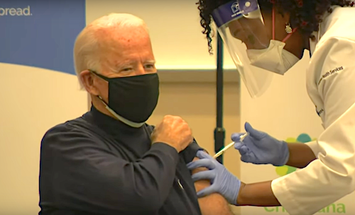 President-elect Joe Biden receives the first dose of a two-shot coronavirus vaccination from nurse practitioner Tabe Masa at the ChristianaCare Hospital in Newark, Delaware, on Dec. 21.