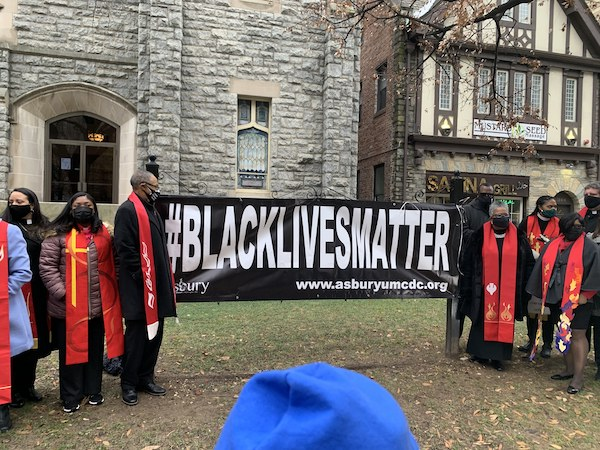 "A ""Black Lives Matter"" banner is placed in front of Asbury United Methodist Church in northwest D.C. on Dec. 18, days after a similar one was stolen and destroyed during a pro-President Trump rally in the city. (Hamil R. Harris/The Washington Informer)"