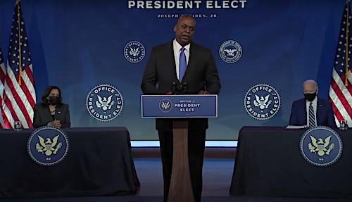 Retired Army Gen. Lloyd Austin, President-elect Joe Biden's nominee for defense secretary. speaks during a Dec. 9 press conference in Wilmington, Delaware, to announce the nomination as Biden (right) and Vice President-elect Kamala Harris look on.