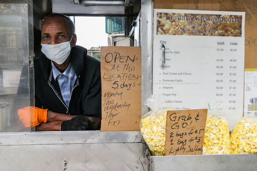 Mike Habteselasse works his popcorn vending stand at 7th and D streets in southwest D.C. (Shevry Lassiter/The Washington Informer)