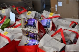 Bags of food are placed in a parking lot at the Wayne K. Curry Administration Building in Largo, Maryland, for essential workers in Prince George's County during a grab-and-go luncheon on Dec. 30. (Anthony Tilghman/The Washington Informer)