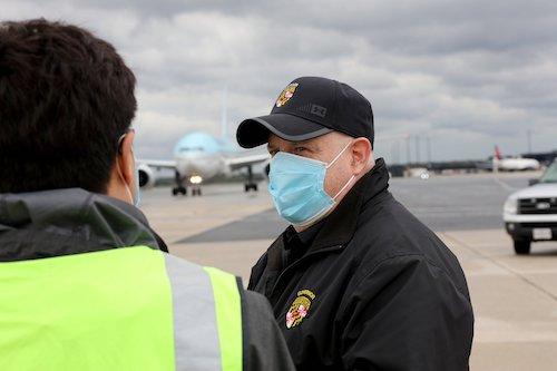 **FILE** Maryland Gov. Larry Hogan waits on the tarmac at Baltimore/Washington International Thurgood Marshall Airport as a shipment of coronavirus testing kits arrives on April 18. (Courtesy of Governor's Office via Twitter)