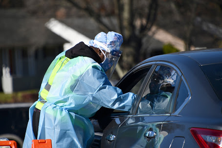 **FILE** Officials from Greater Baden Medical Services conduct coronavirus tests at a drive-thru testing site in District Heights, Maryland, on Nov. 20, 2020. (Anthony Tilghman/The Washington Informer)
