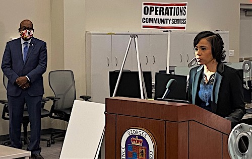 Prince George's County Executive Angela Alsobrooks speaks during a Dec. 10 press conference at the county's Emergency Operations Center to announce new coronavirus-related restrictions as Dr. George Askew, deputy chief administrative officer for health, human services and education, listens. (William J. Ford/The Washington Informer)