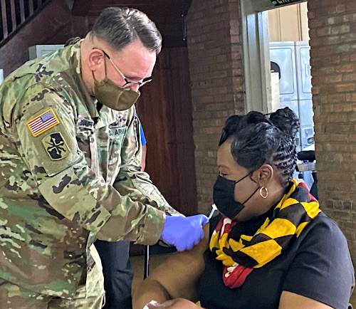 Donyelle Cottingham, a high school counselor in Wicomico County, Maryland, receives a dose of a coronavirus vaccine at St. John's College in Annapolis on Jan. 21. (William J. Ford/The Washington Informer)