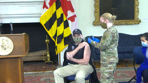 Maryland Gov. Larry Hogan receives the first round of the two-shot coronavirus vaccine in Annapolis on Jan. 18.